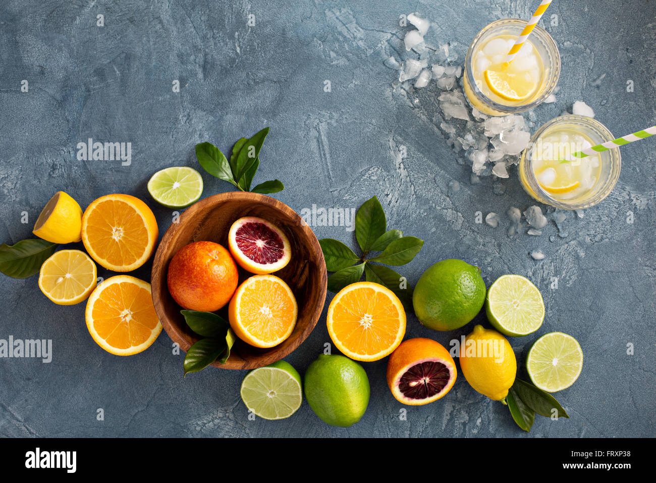 Citrus fruits background with oranges, limes and lemons - Stock Image