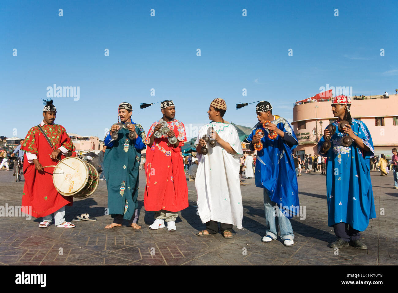 Musicians in colourful clothes at the Jemaa el-Fnaa square in Marrakesh, Morocco Stock Photo