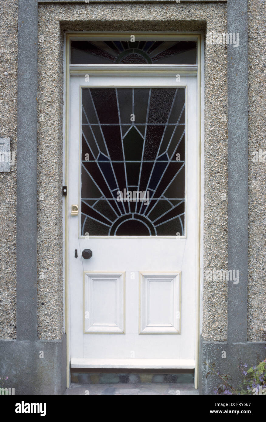 Close-up of a white front door with a glazed thirties sunburst stained glass panel & Close-up of a white front door with a glazed thirties sunburst Stock ...