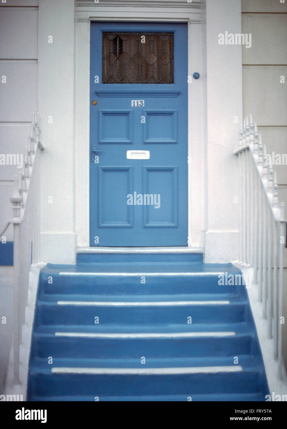 Blue Steps To Success: Blue Painted Steps Up To Blue Front Door Of A White