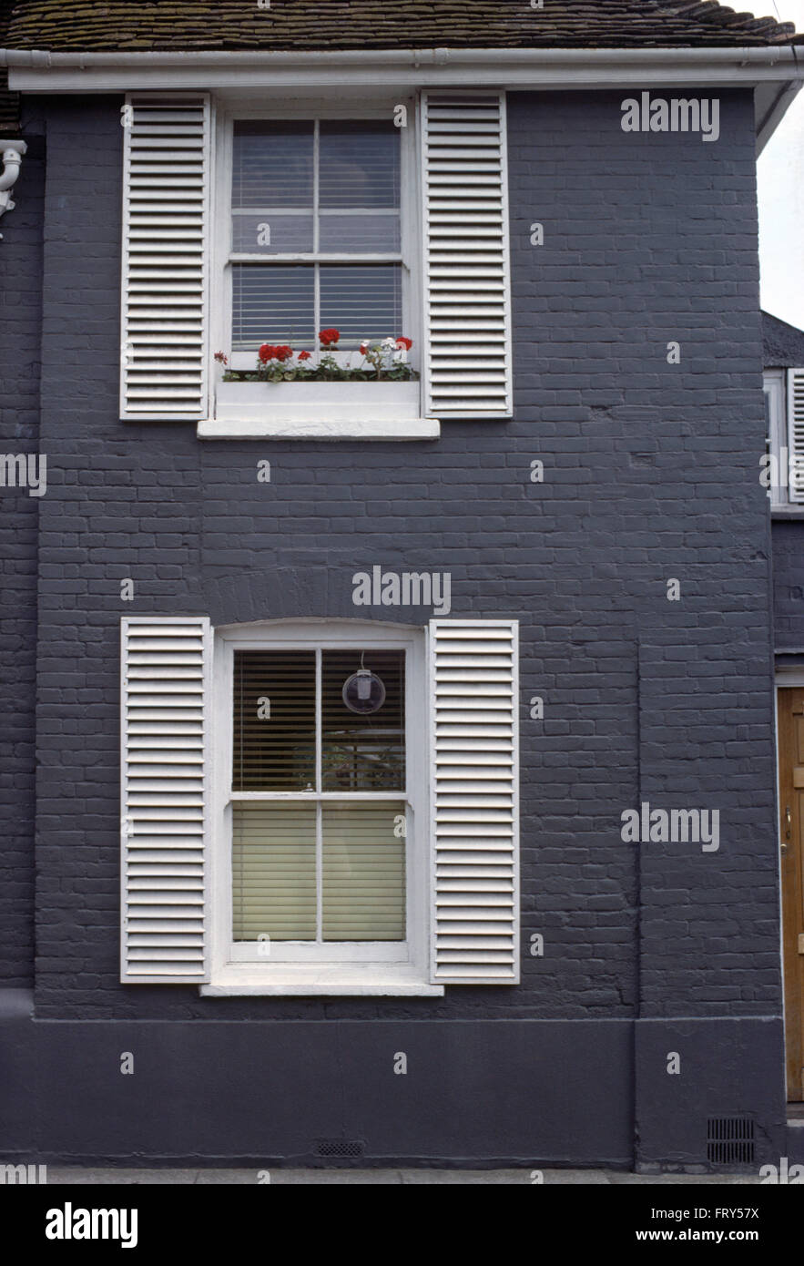 Exterior Of Blue House With White Louvre Shutters On The