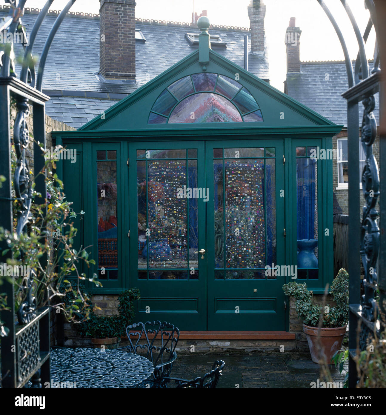 Exterior Of Green Painted Conservatory With Patterned Glass