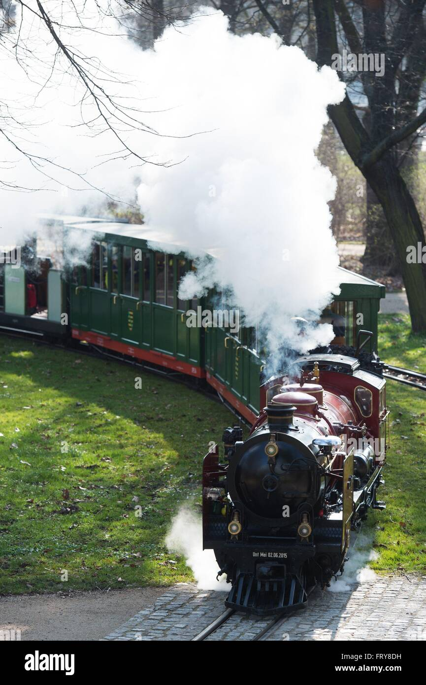 Dresden, Germany. 24th Mar, 2016. A steam locomotive of the Dresden park railway makes its way through the public - Stock Image