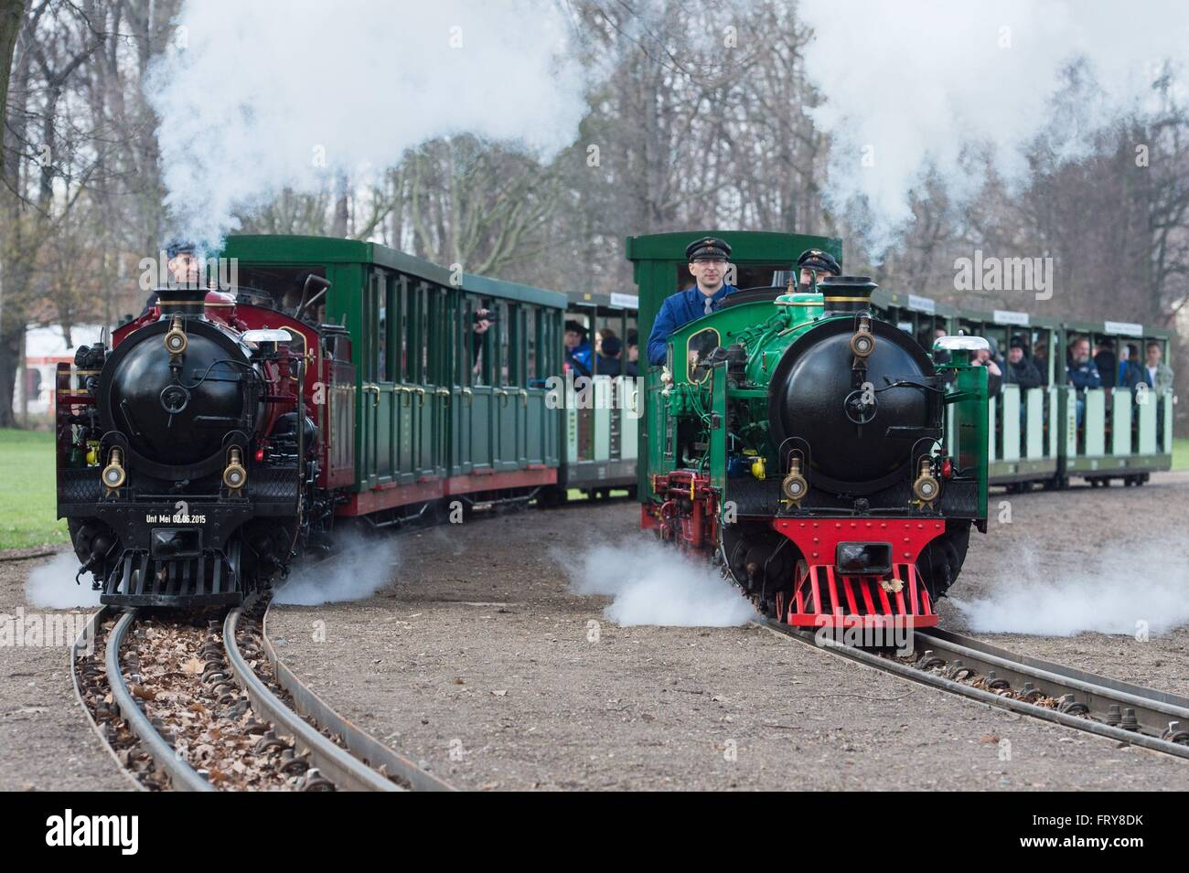 Dresden, Germany. 24th Mar, 2016. Two steam locomotives of the Dresden park railway make their way through the public - Stock Image