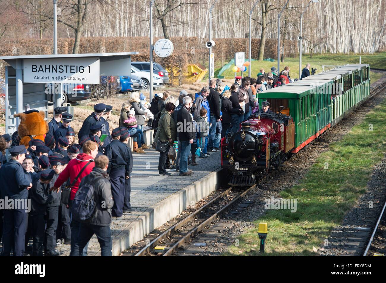 Dresden, Germany. 24th Mar, 2016. A steam locomotive of the Dresden park railway approaches a station in the public - Stock Image
