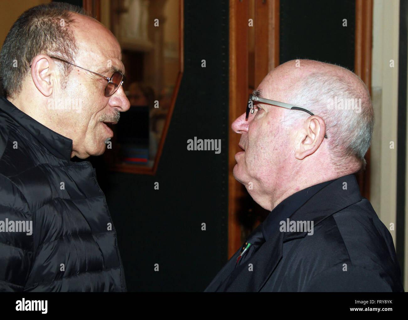 Udine, Italy. 24th Mar, 2016. Carlo Tavecchio (R) President of Italian Football Federation (FIGC) talks with Franco Stock Photo