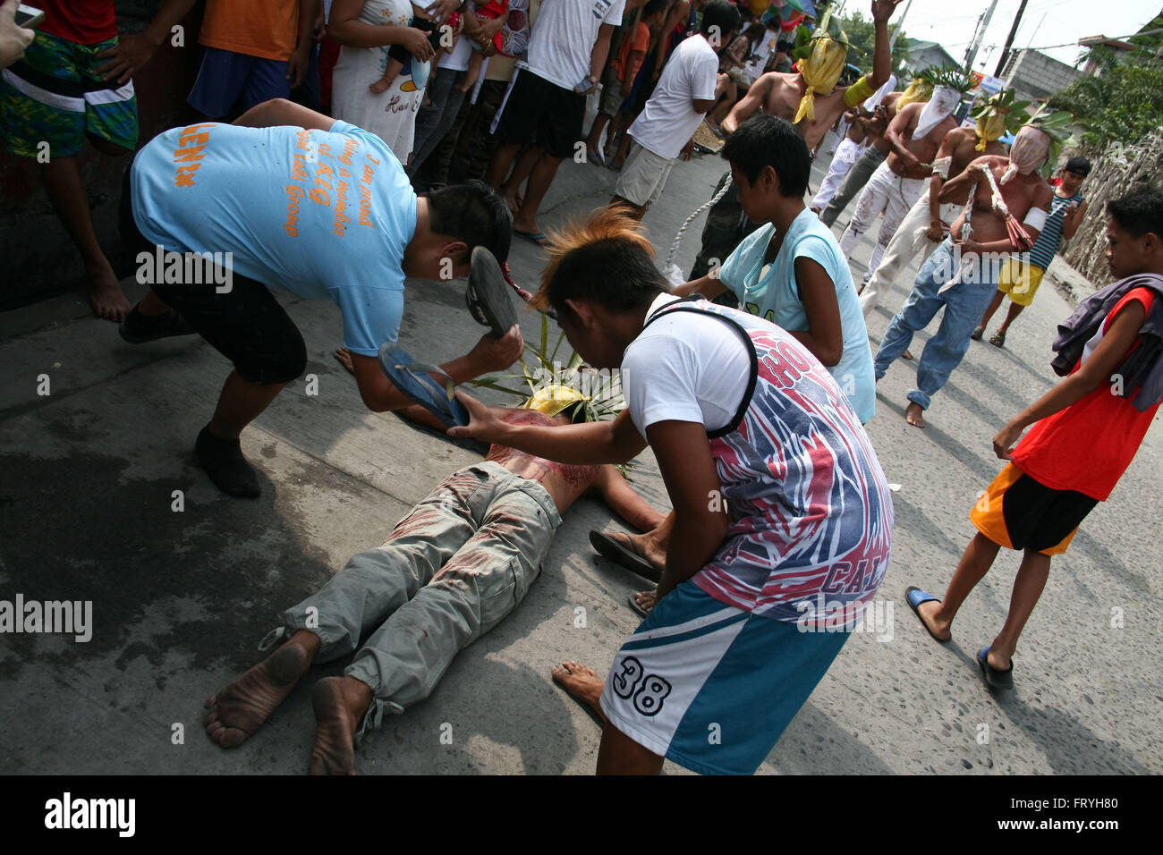 Philippines. 25th Mar, 2016. A penitent is hit with srubber slippers in San Fernando, Pampanga. Flagellants use - Stock Image