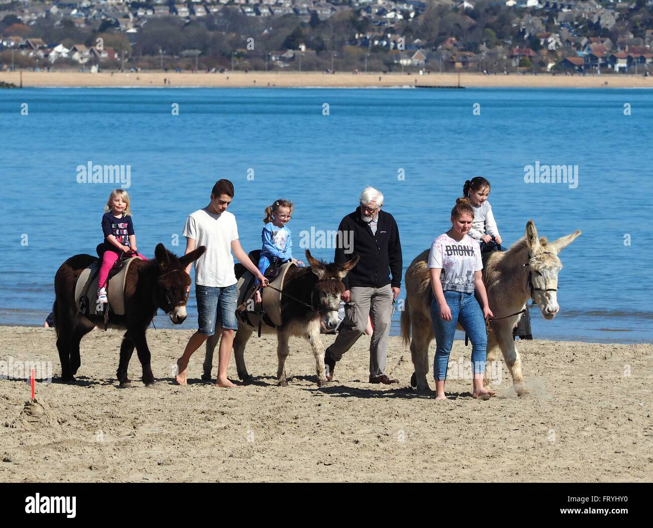 Donkey ride on the beach at Weymouth, Dorset, UK - Stock Image