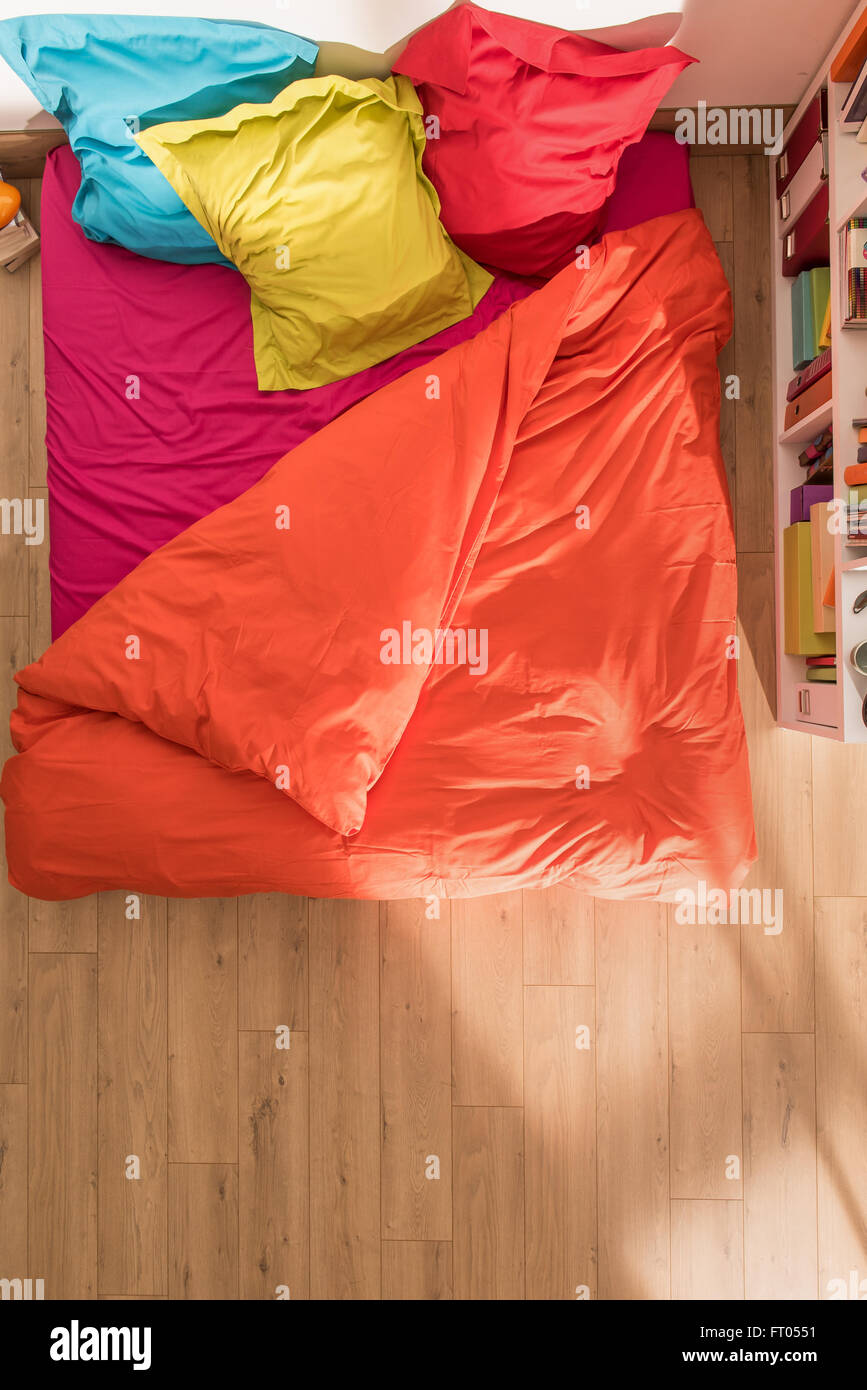 Top View Of An Open Bed With A Duvet And Brightly Colored Pillows In Stock Photo Alamy