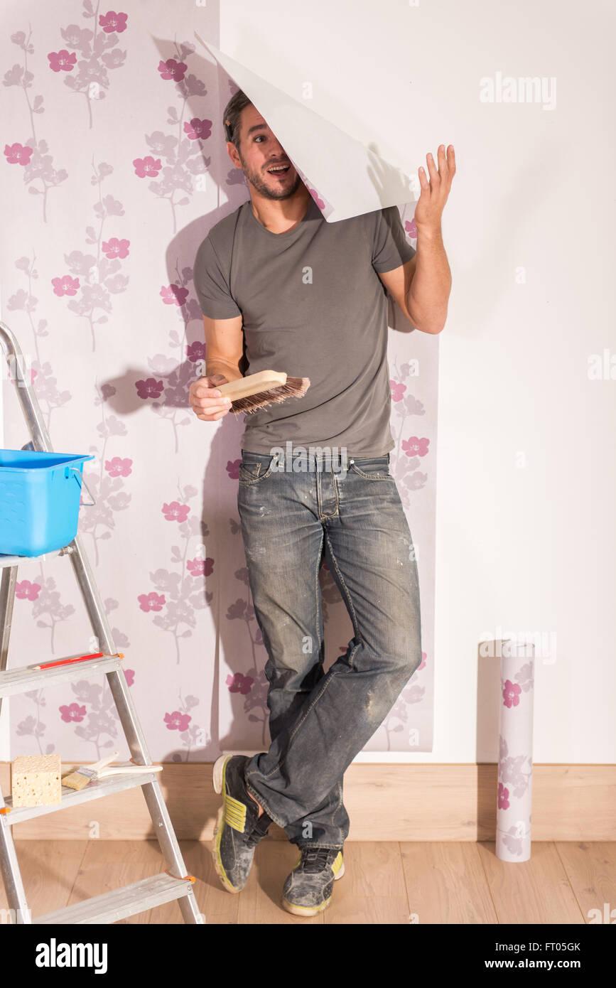 Looking At Camera Humorous Handyman Posing Wallpaper Poses With His Stock Photo Alamy