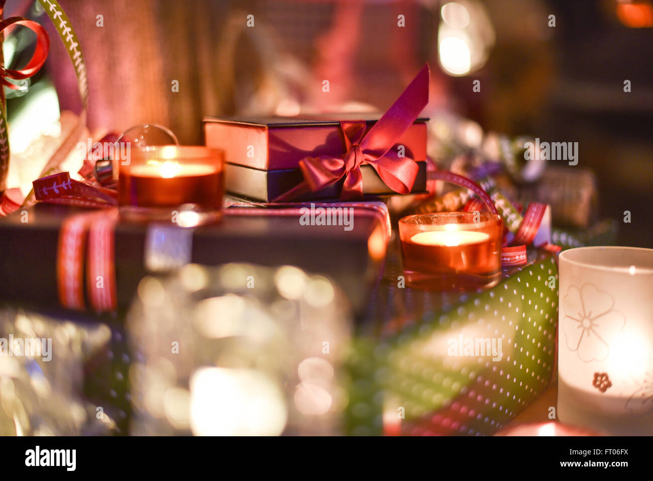 Christmastime, a lot of beautiful gifts under the Christmas  tree illuminated in the warm atmosphere of Christmas - Stock Image