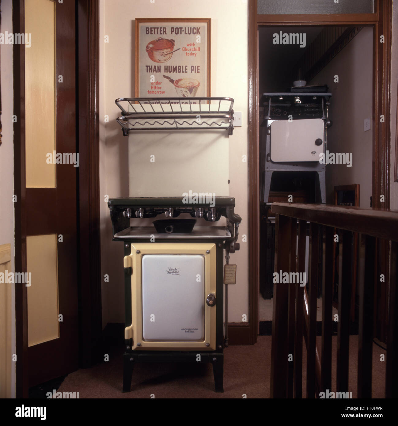 Collection of vintage gas cookers on fifties landing - Stock Image