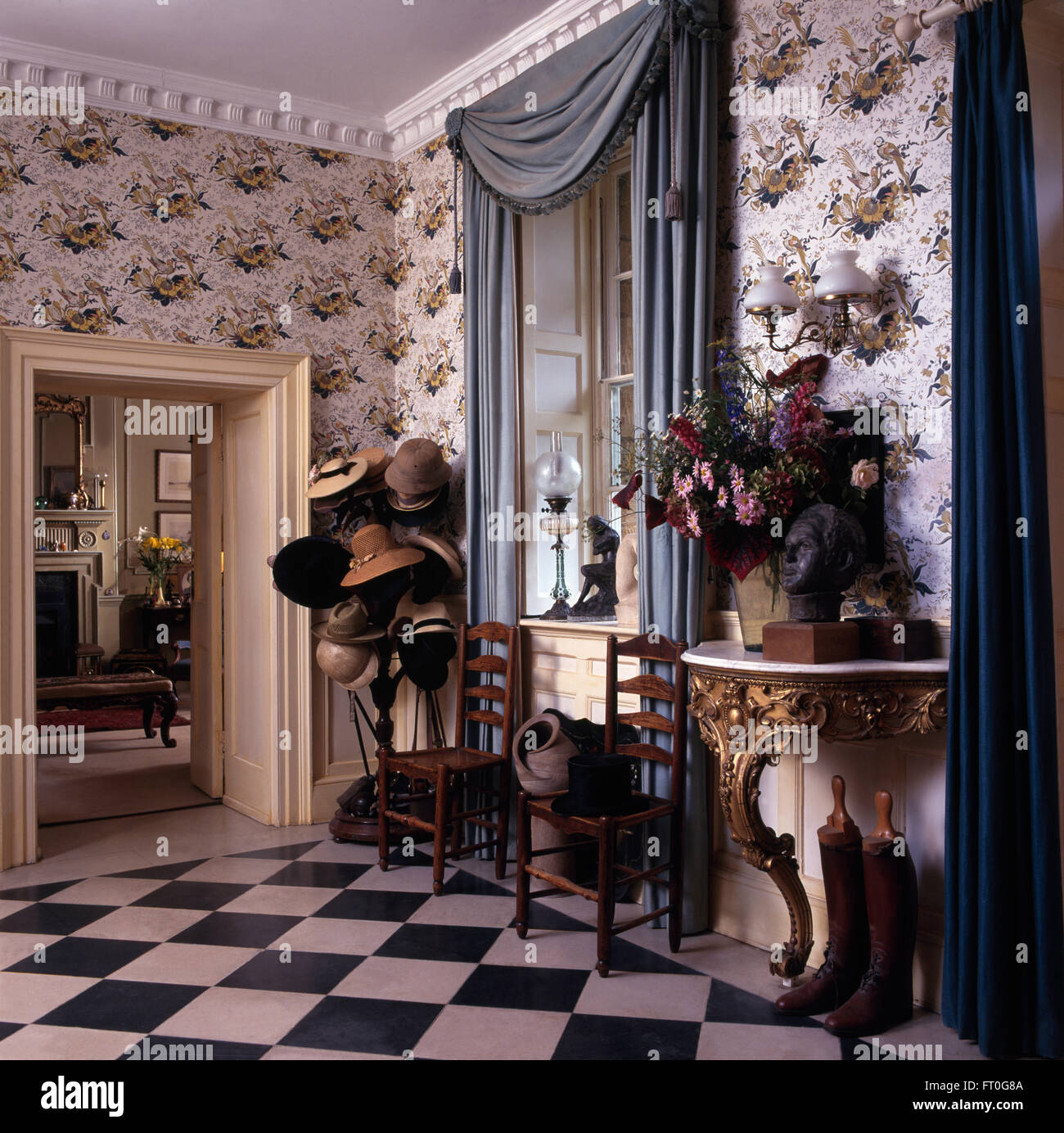 Blue Swagged Drapes And Patterned Wallpaper In Georgian Hall With