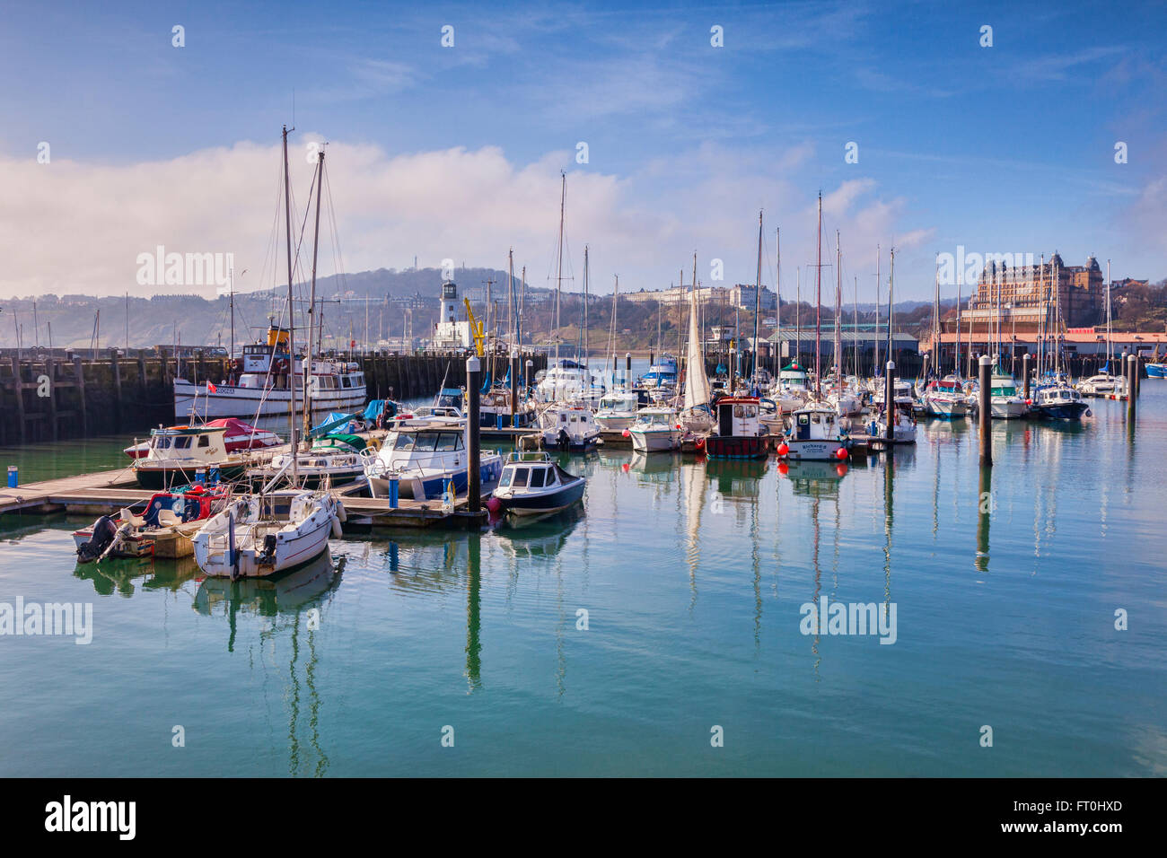 Scarborough Harbour, with the Grand Hotel and Oliver's Mount in the distance,  North Yorkshire, England, UK - Stock Image