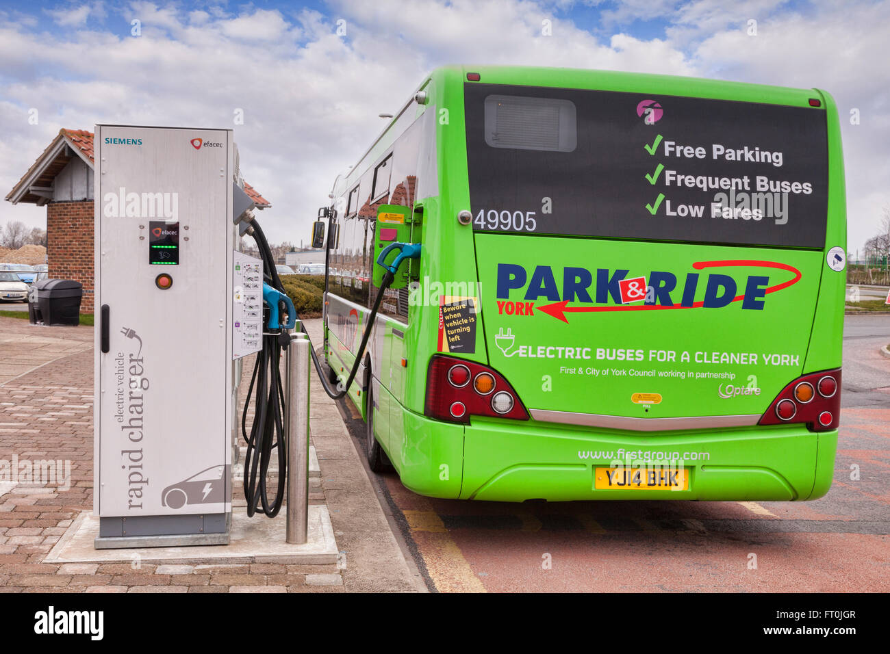 Electric bus being recharged at Siemens Electric Vehicle Rapid Charger, at York Park and Ride, York, North Yorkshire, - Stock Image