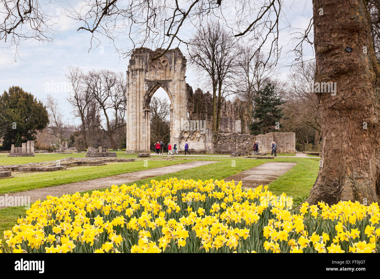 Group of tourists explore St Mary's Abbey, York, North Yorkshire, England, UK - Stock Image