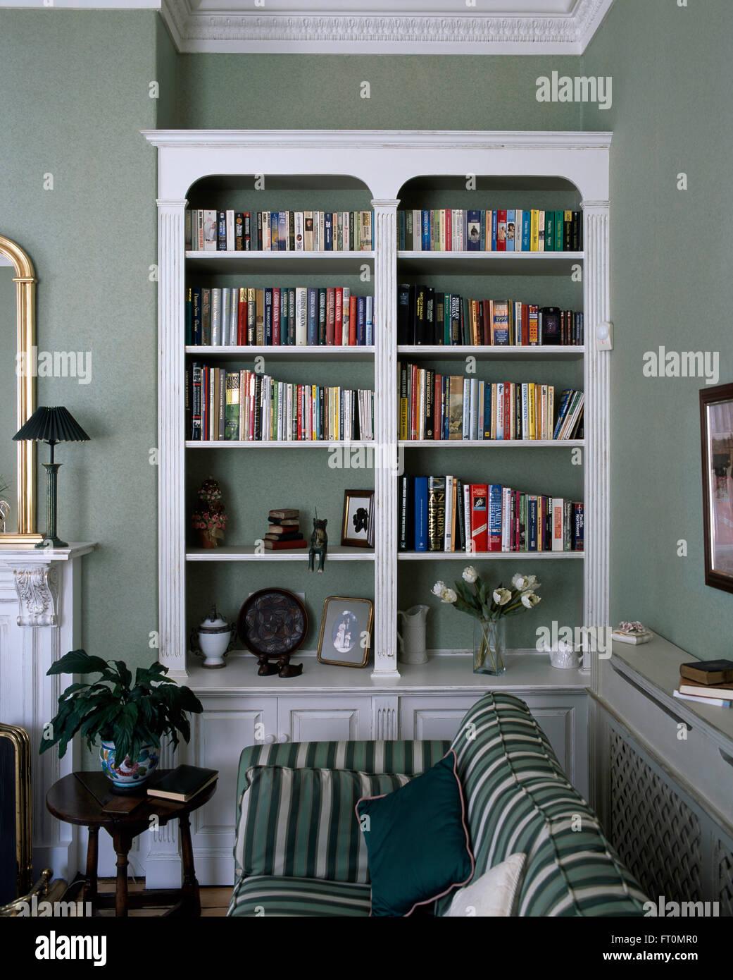 White bookshelves in a gray-green living room Stock Photo: 100819908 ...
