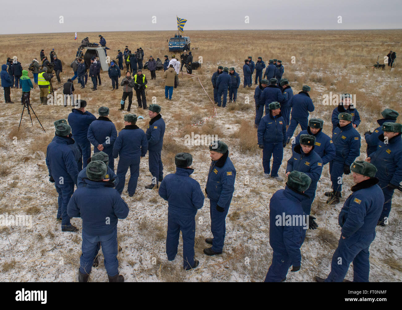 Russian Search and Rescue teams are seen at the Soyuz TMA-18M spacecraft landing site after Expedition 46 Commander - Stock Image