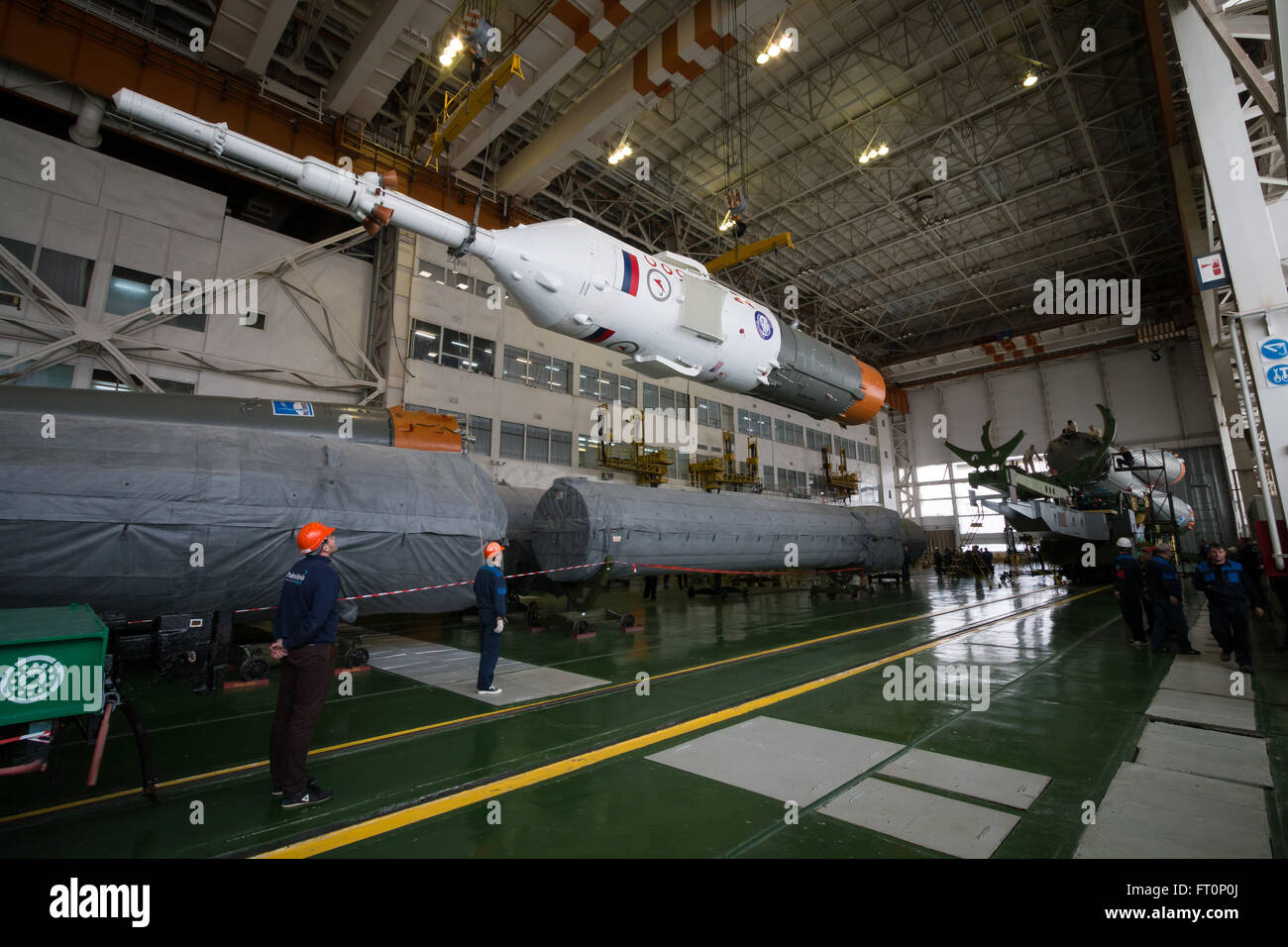 The Soyuz rocket and Soyuz TMA-20M spacecraft is assembled Tuesday, March 15, 2016 at the Baikonur Cosmodrome in - Stock Image
