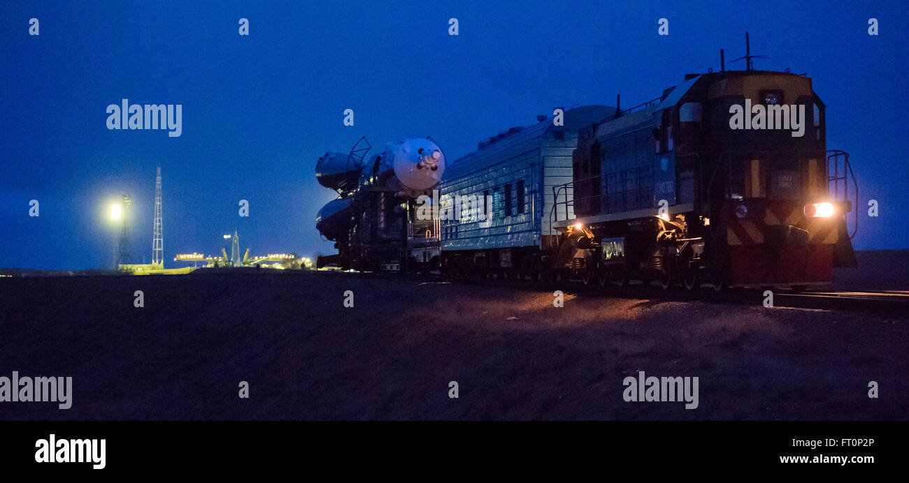 The Soyuz TMA-20M spacecraft is rolled out to the launch pad by train in the early hours of Wednesday, March 16, - Stock Image