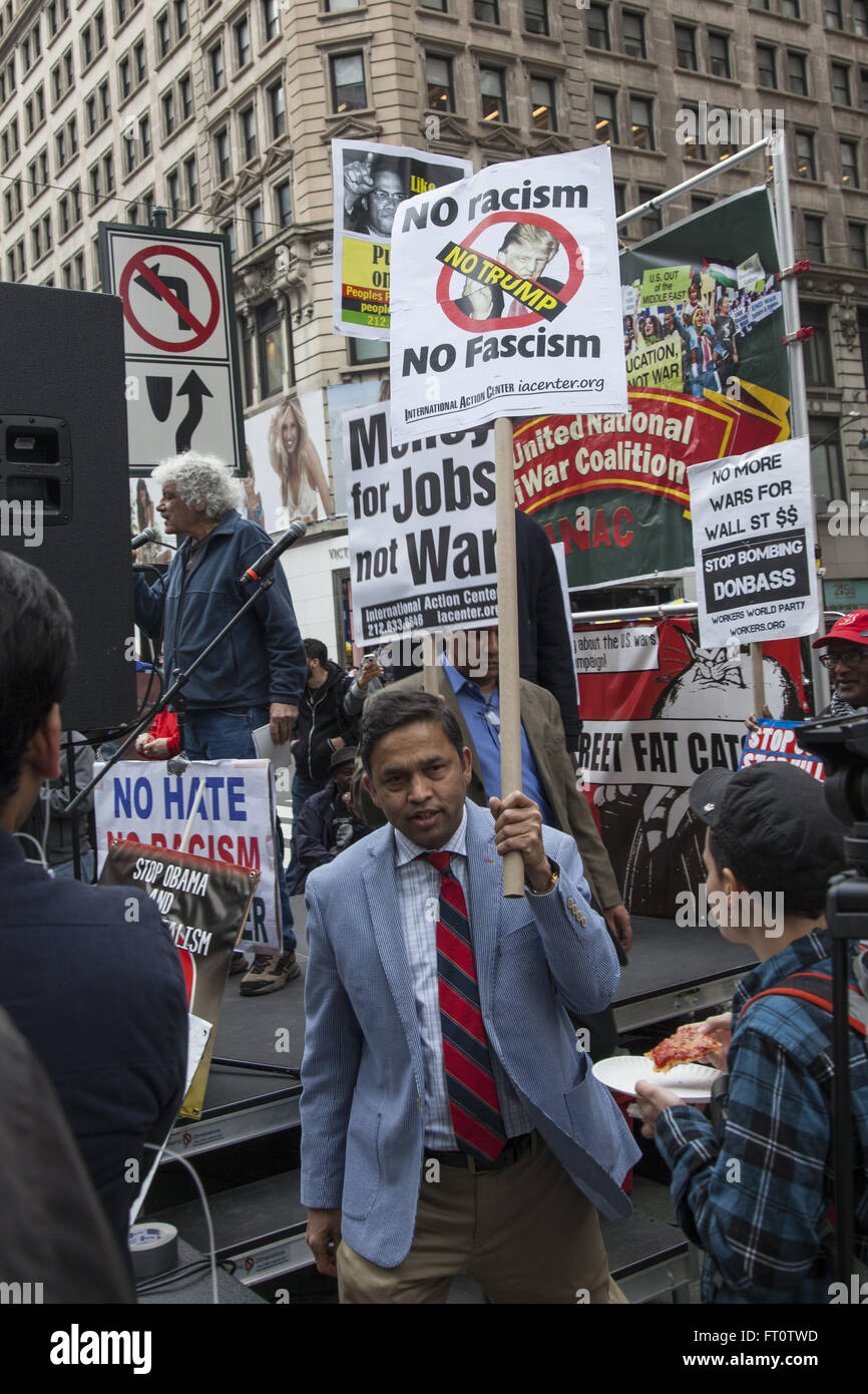 Demonstration against U.S. wars abroad and for social justice at home in Harold Square, NYC. - Stock Image