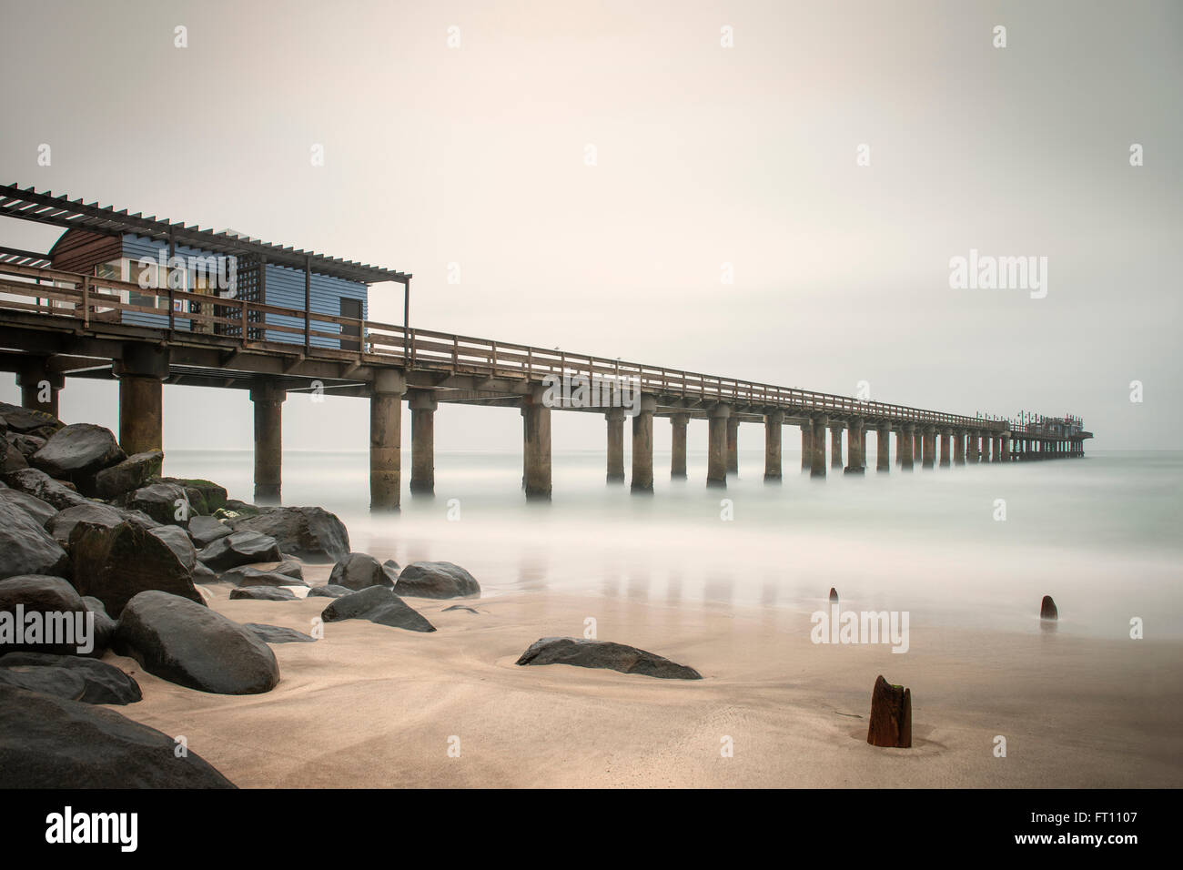 Jetty with restaurant on Swakopmund beach, Namibia, Atlantic Ocean, Africa - Stock Image