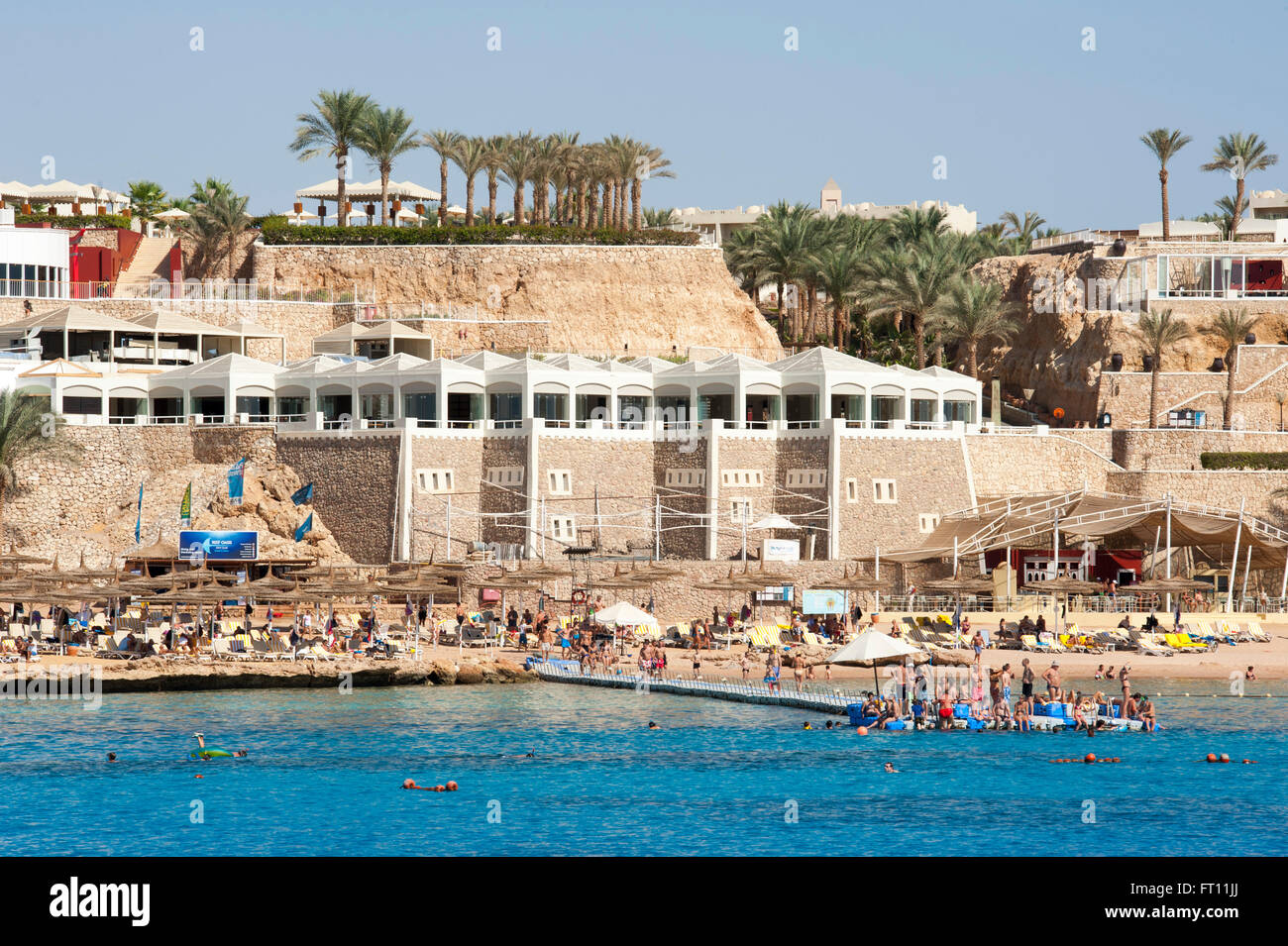 People bathing in Red Sea, Sharm el-Sheikh, South Sinai, Egypt - Stock Image