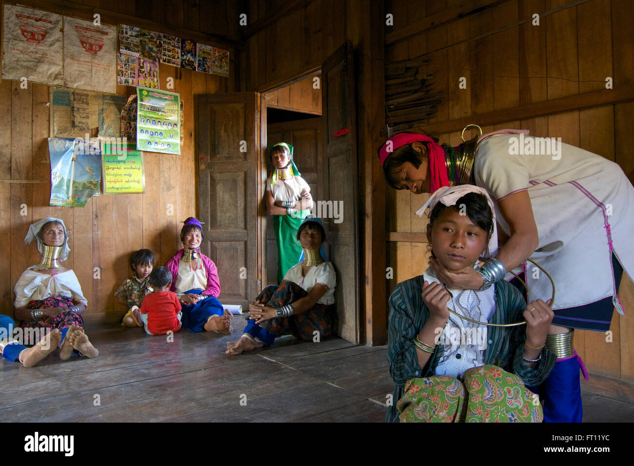 Longneck Karen women wearing typical necklaces, a thirteen year old school girl getting a necklace the first time on er own will, Padaung women near Loikaw, Kayah State, Karenni State, Myanmar, Burma, Asia Stock Photo
