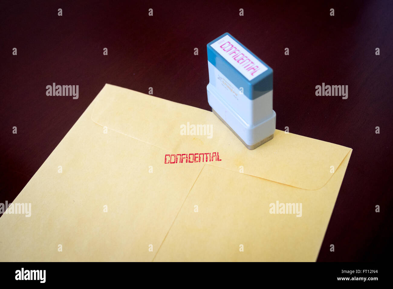 A yellow envelope stamped confidential. - Stock Image