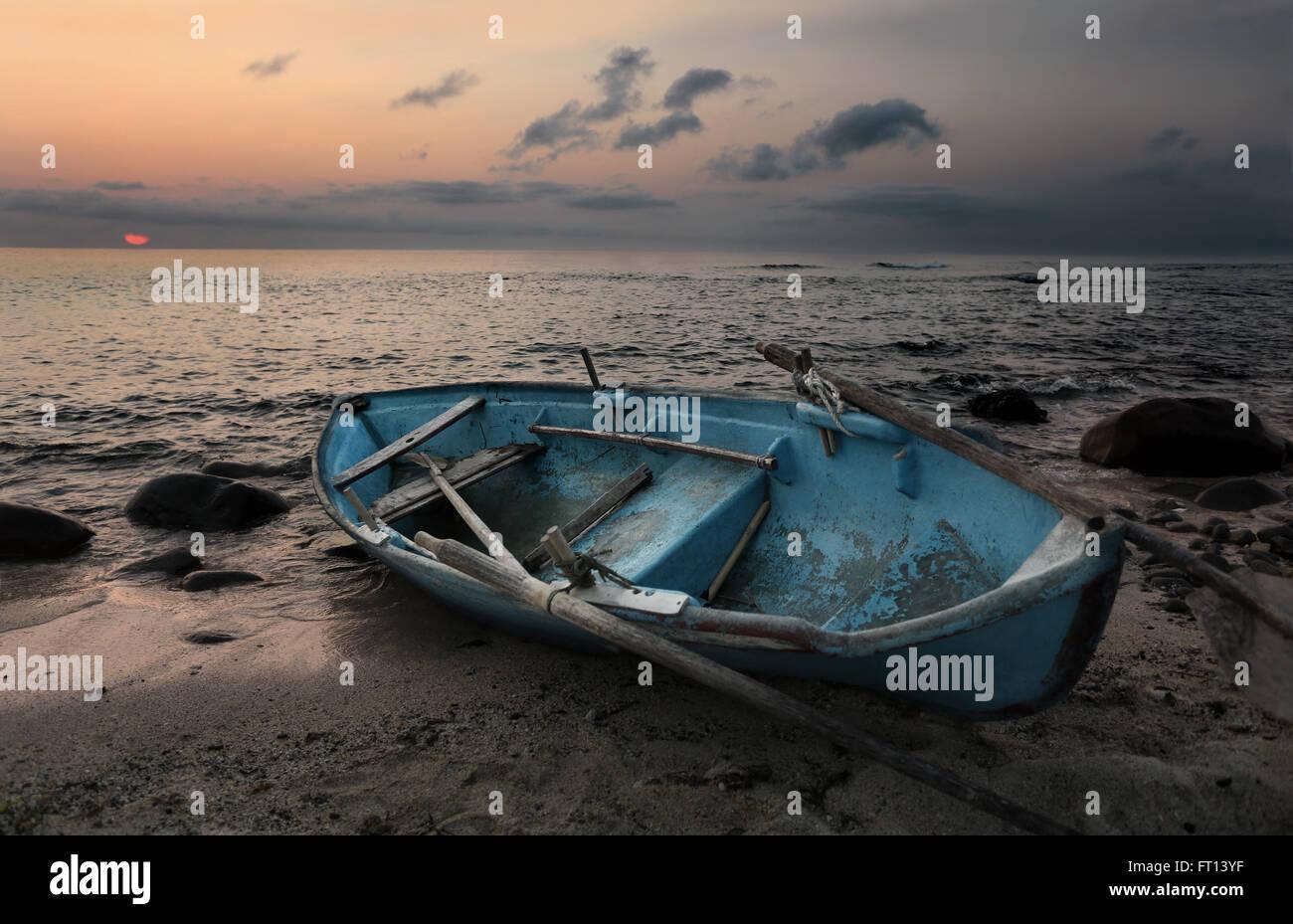 Fishing boat on a beach at sunset, Batan Island, Batanes, Philippines, Asia - Stock Image