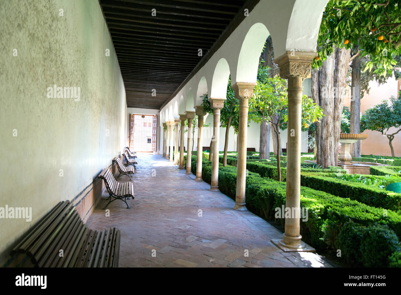 A walking tour of the city of Granada inside the Alhambra Palace with view of the interior garden. Stock Photo