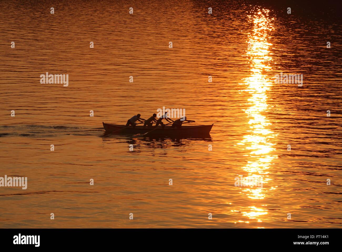 Rowing boat in evening sun, Torri del Benaco, Lake Garda, Verona, Veneto, Italy Stock Photo