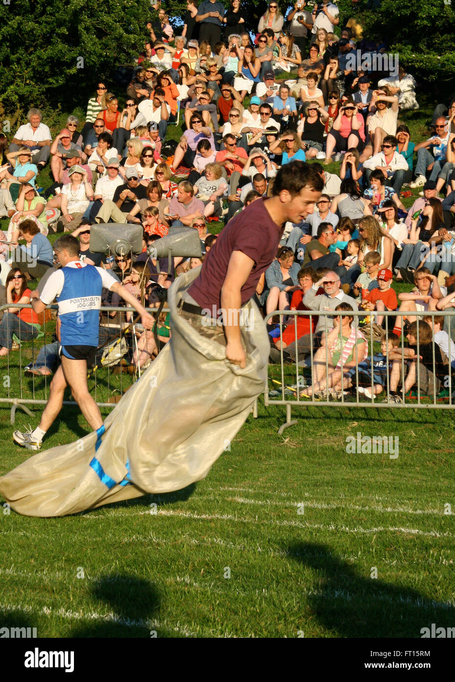 Competitor taking part in sack race Stock Photo