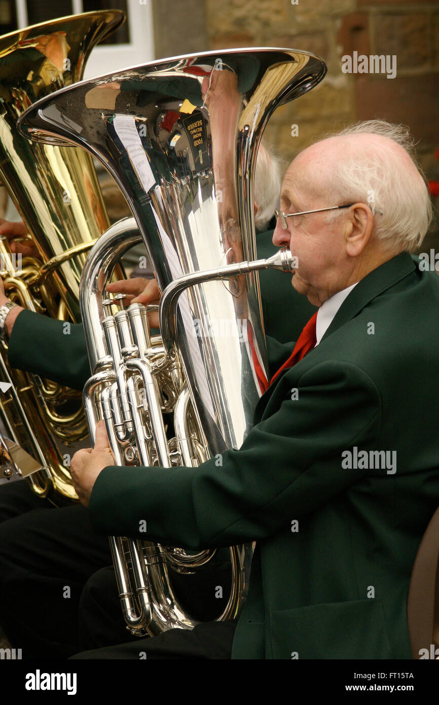 Horn player in brass band - Stock Image