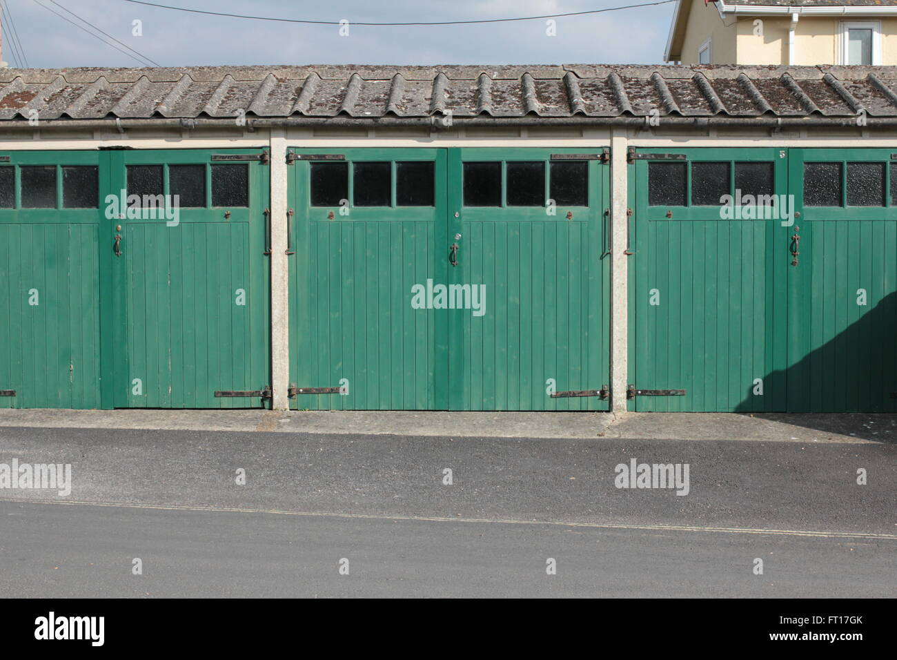wooden green doors with windows and roof - Stock Image