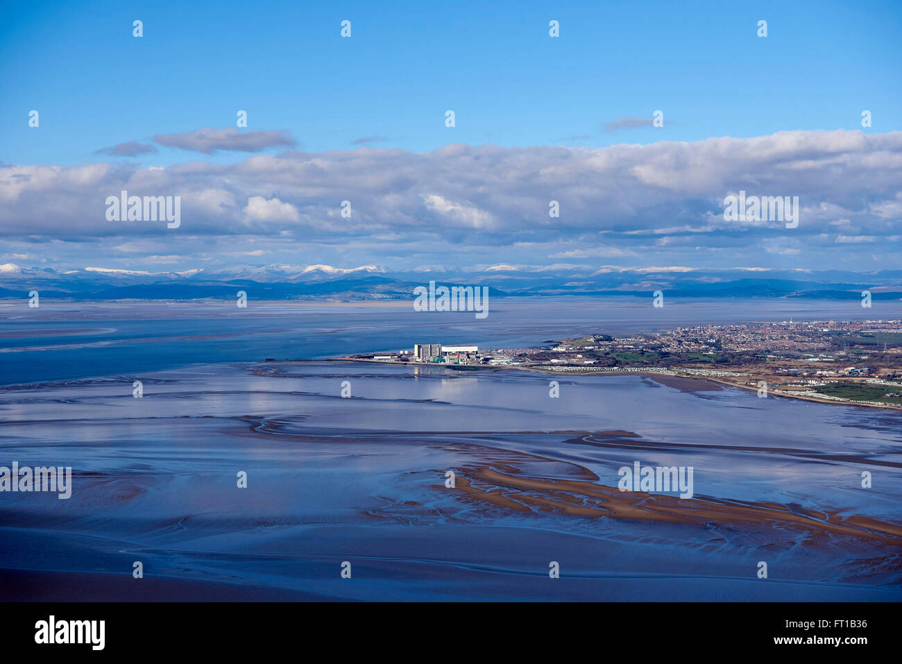 Heysham Nuclear Power Station, with Morecambe Bay and the Lake District behind, NW England, UK - Stock Image
