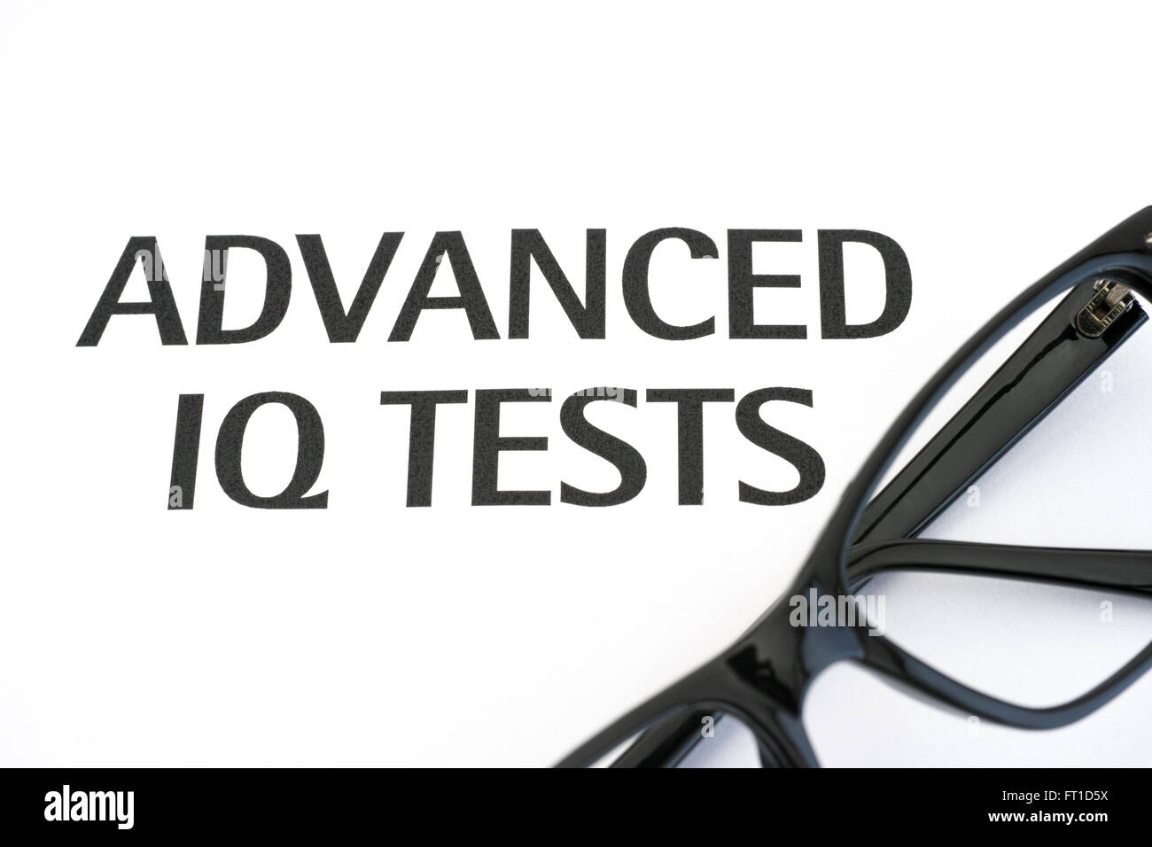 Advanced IQ tests with glasses - Stock Image
