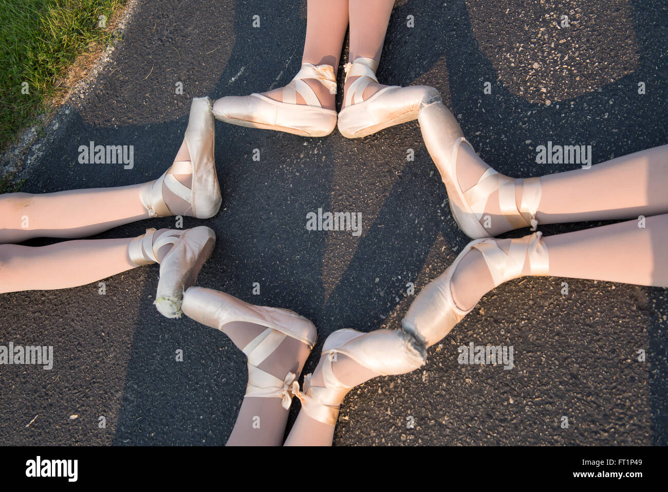 A Circle of Ballet Feet in Pointe shoes - Stock Image
