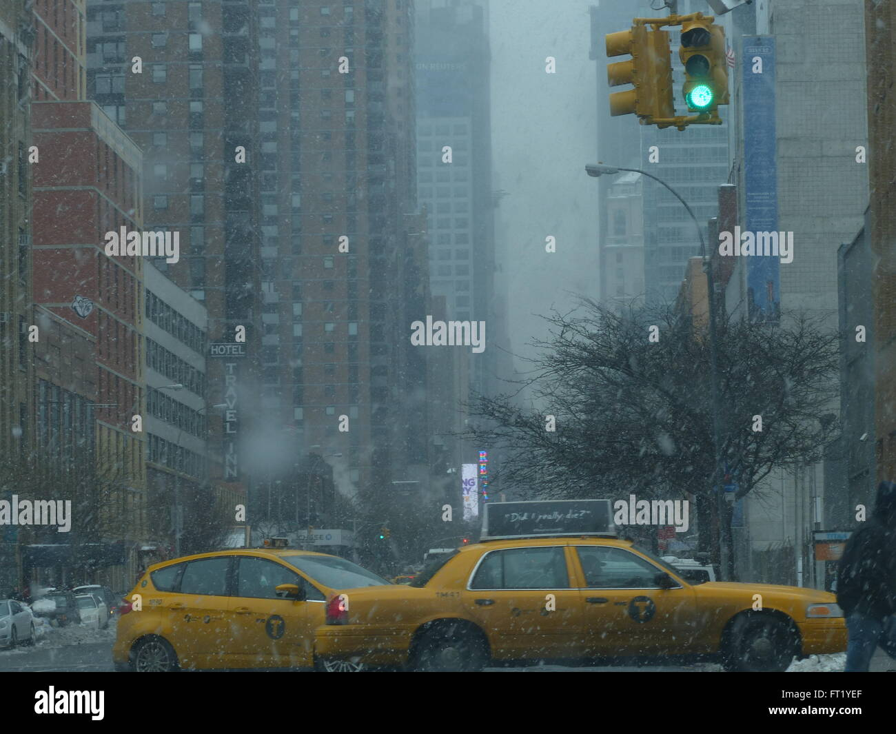 NYC taxicab during snow storm - Stock Image