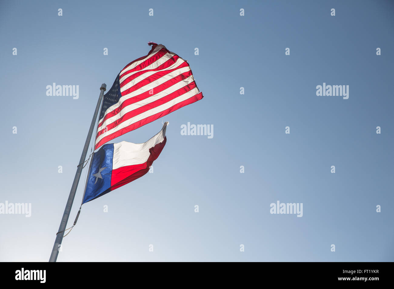 Flats flying for America and Texas - Stock Image