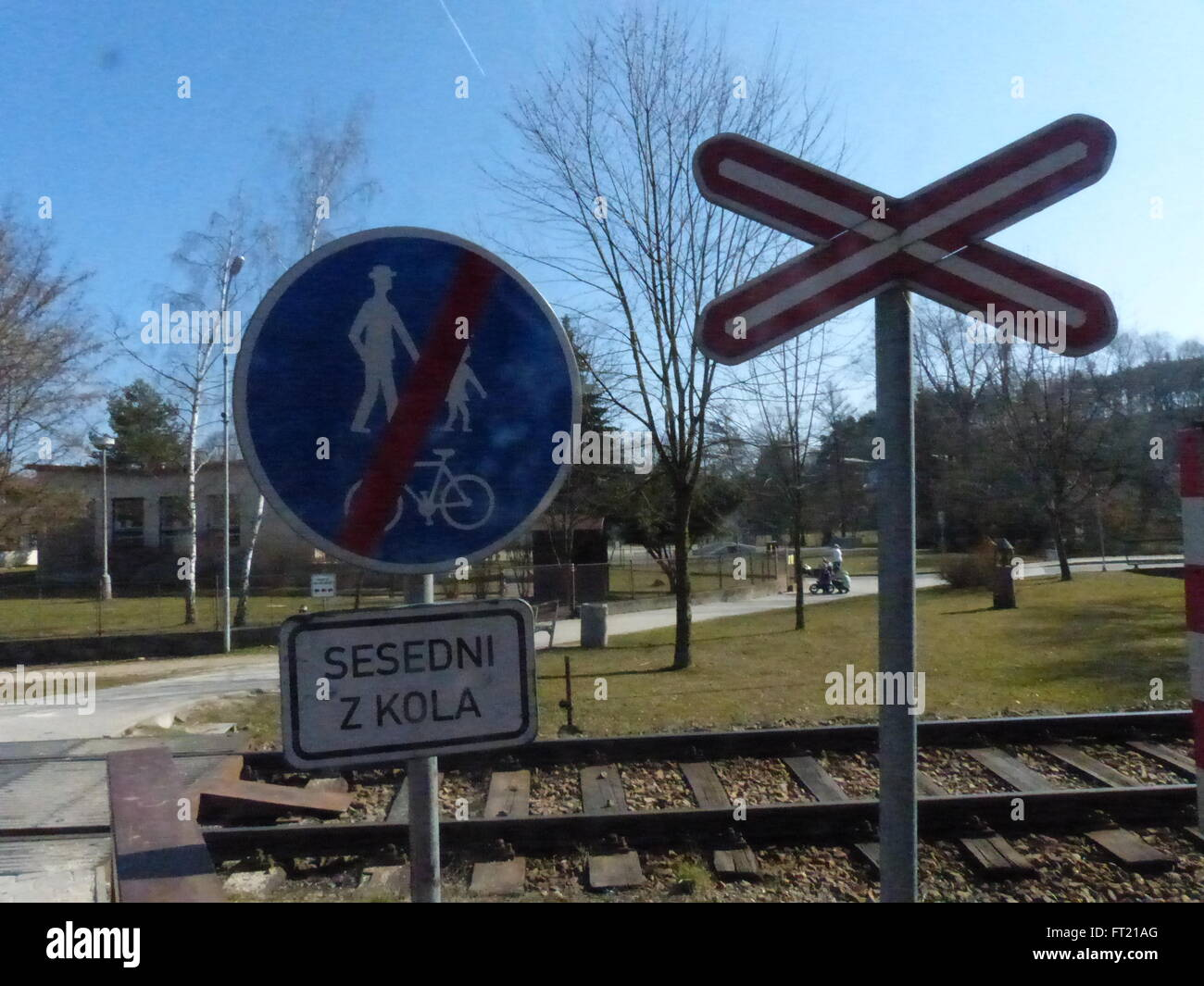 Railroad crossing with sign prohibiting pedestrians and bicycles - Stock Image