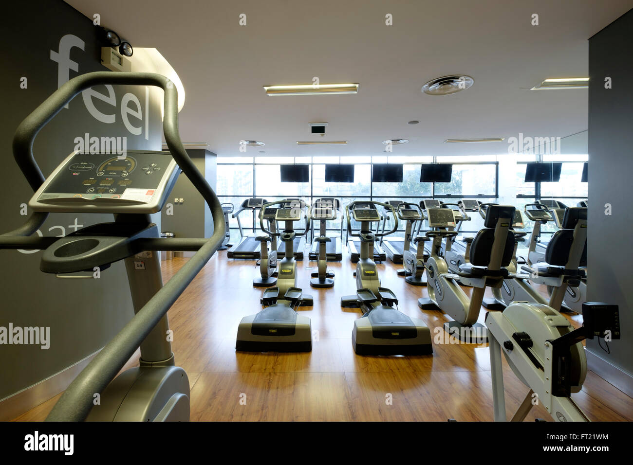 Exercise machines on an empty gym - Stock Image