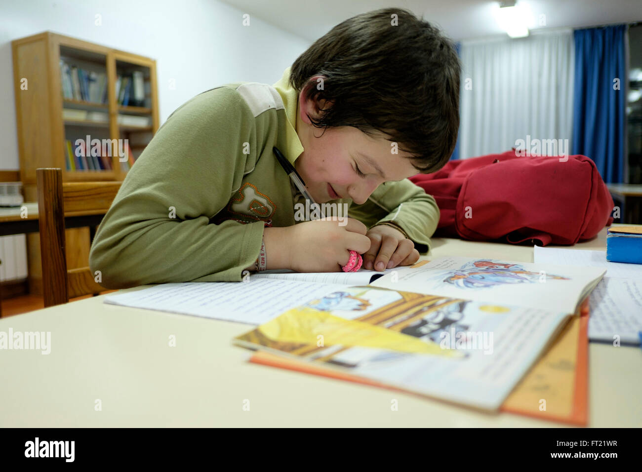 Young boy doing homework at home - Stock Image