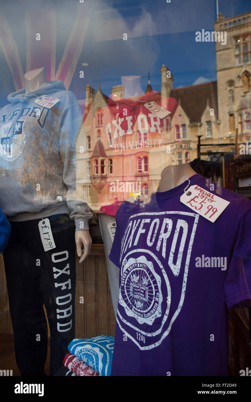 A shop front in the Unviersity city of Oxford, UK selling souvenier t shirts, sweat tops and tourist things with - Stock Image