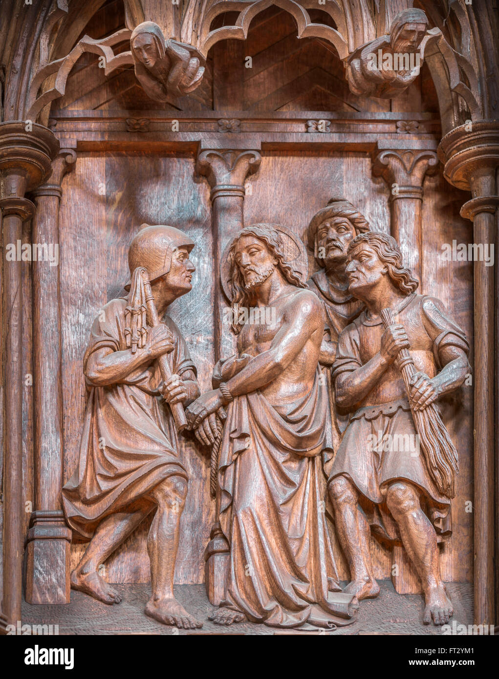Jesus is flogged by roman soldiers, one of a series of fourteenth century wooden carvings illustrating the life - Stock Image