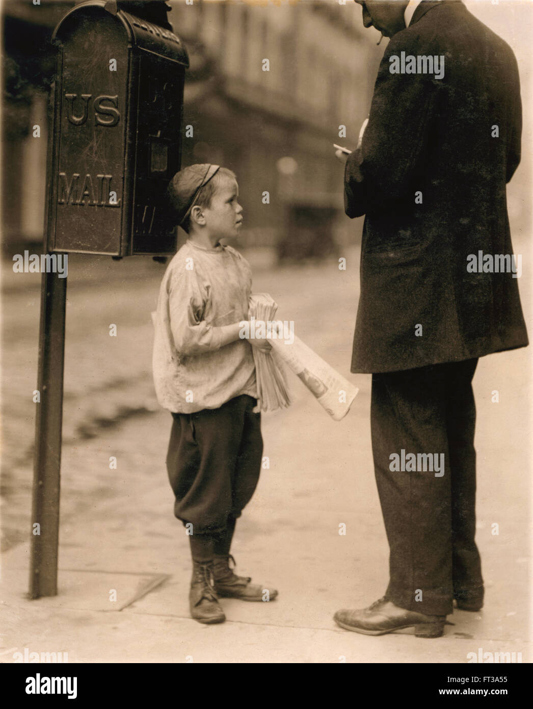7-year-old Newsboy Selling Newspaper to Man Works Every Day 2:30 to 8pm 10am to Midnight on Saturday Earning 50 - Stock Image