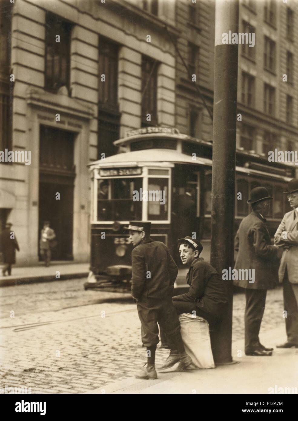 Two Messenger Boys Waiting on Street, Boston, Massachusetts, USA, circa 1910 - Stock Image