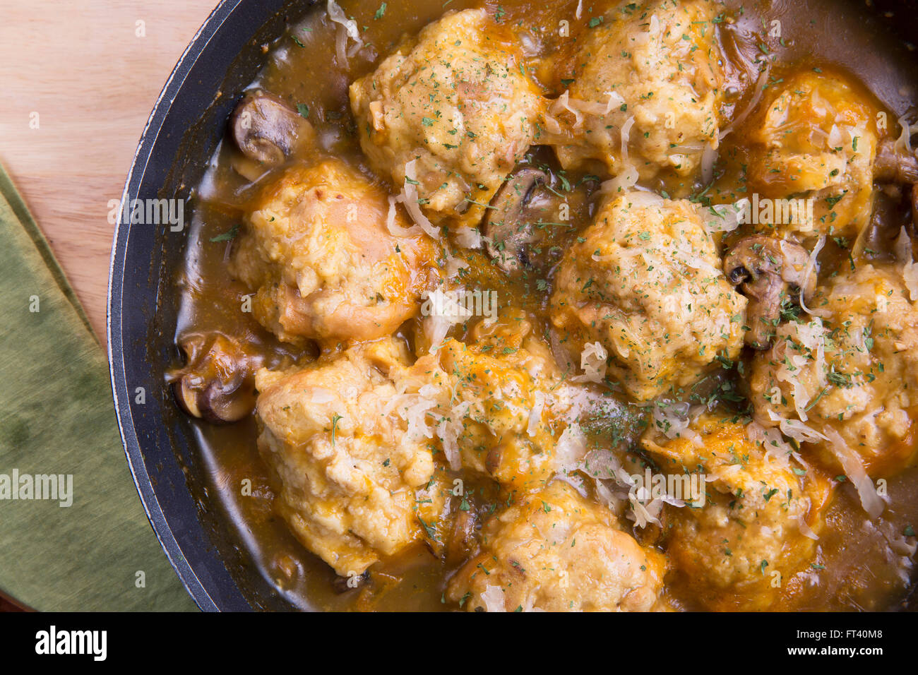 Fresh Bavarian bread dumplings with mushroom gravy sauce. - Stock Image