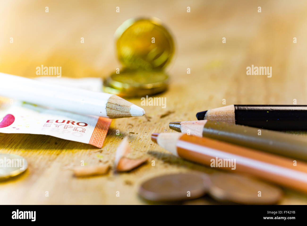 Racism and Money pencil concept - Stock Image