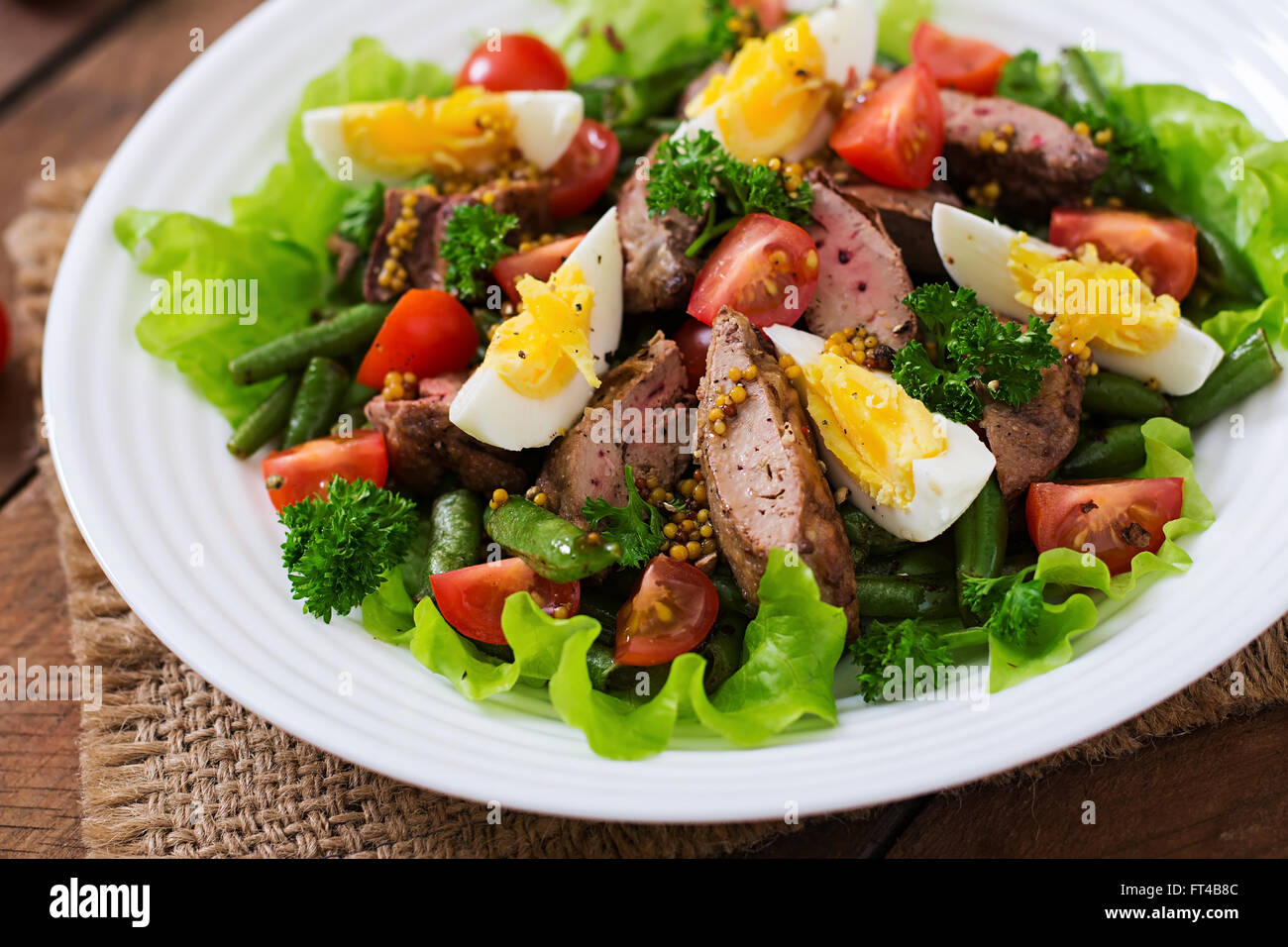 Warm salad with chicken liver, green beans, eggs, tomatoes ...